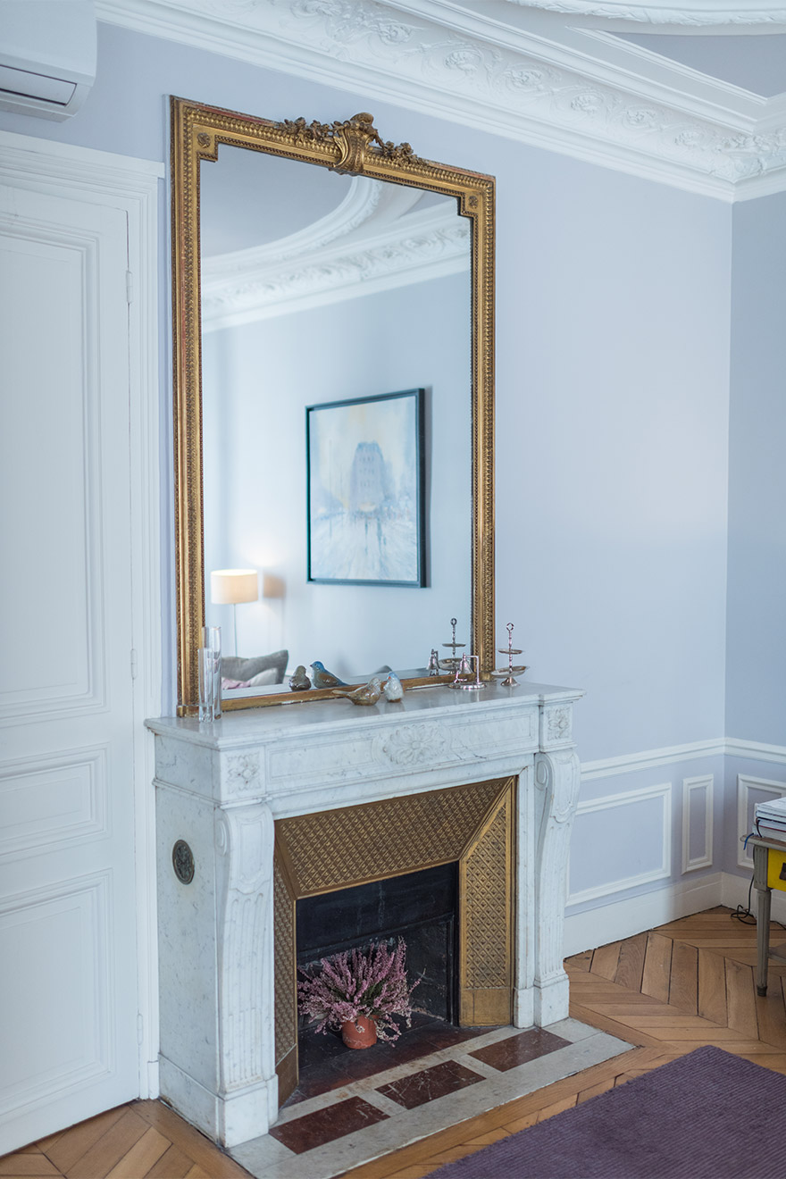 Elegant fireplace in the living room of the Maubert vacation rental offered by Paris Perfect