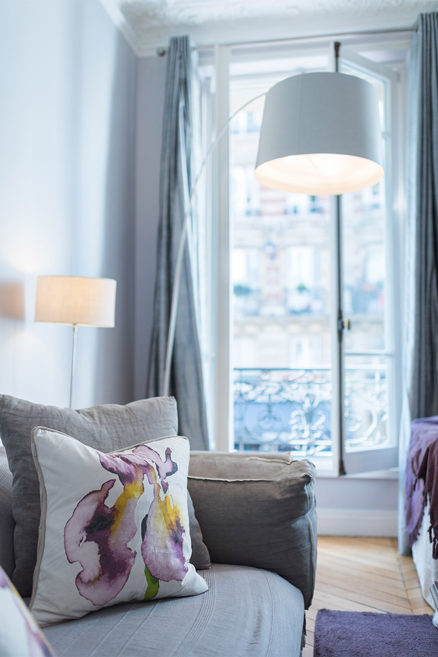 Cool violet tones in the living room of the Maubert vacation rental offered by Paris Perfect