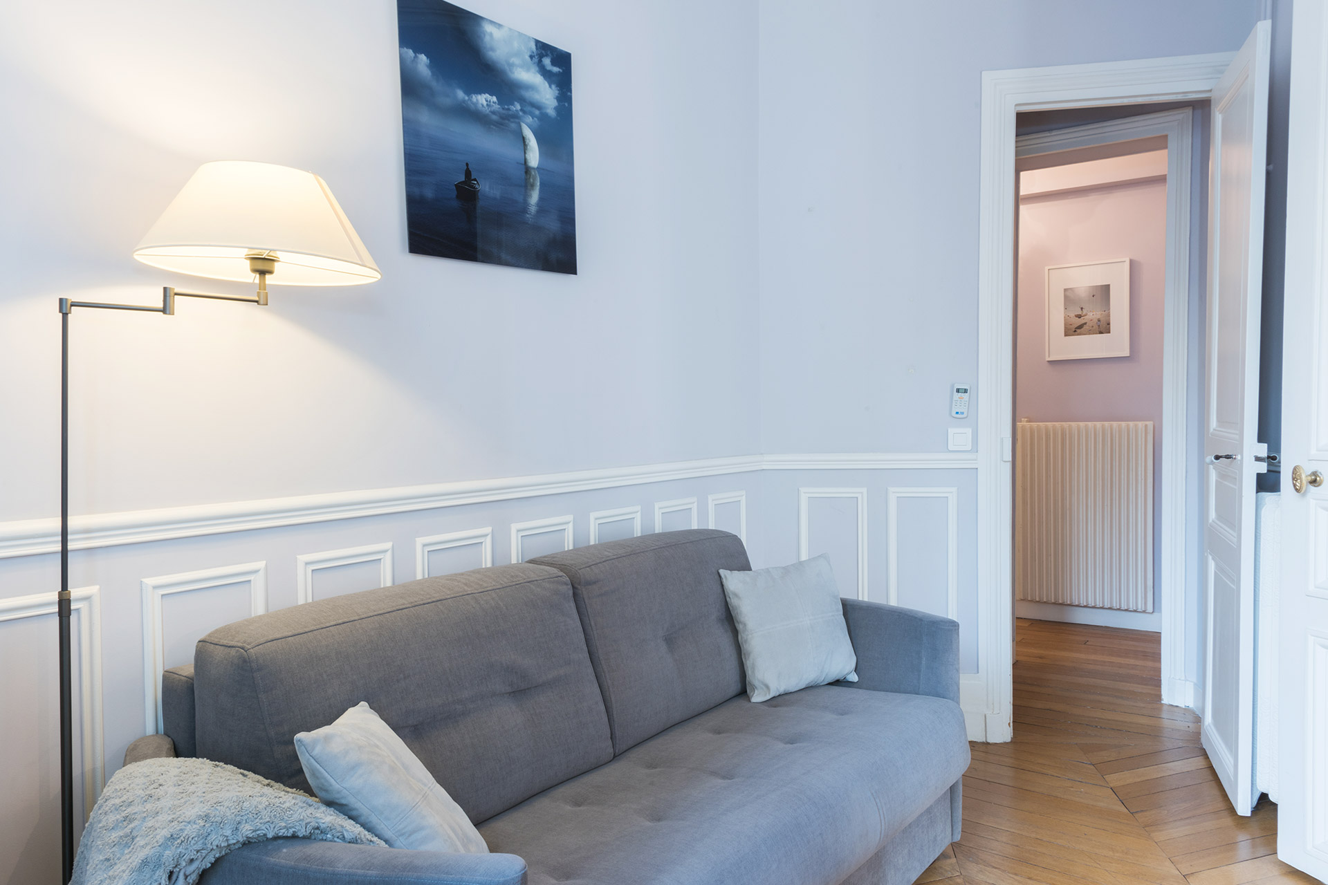 Sofa in the den opens for an additional sleeping space in the Maubert vacation rental