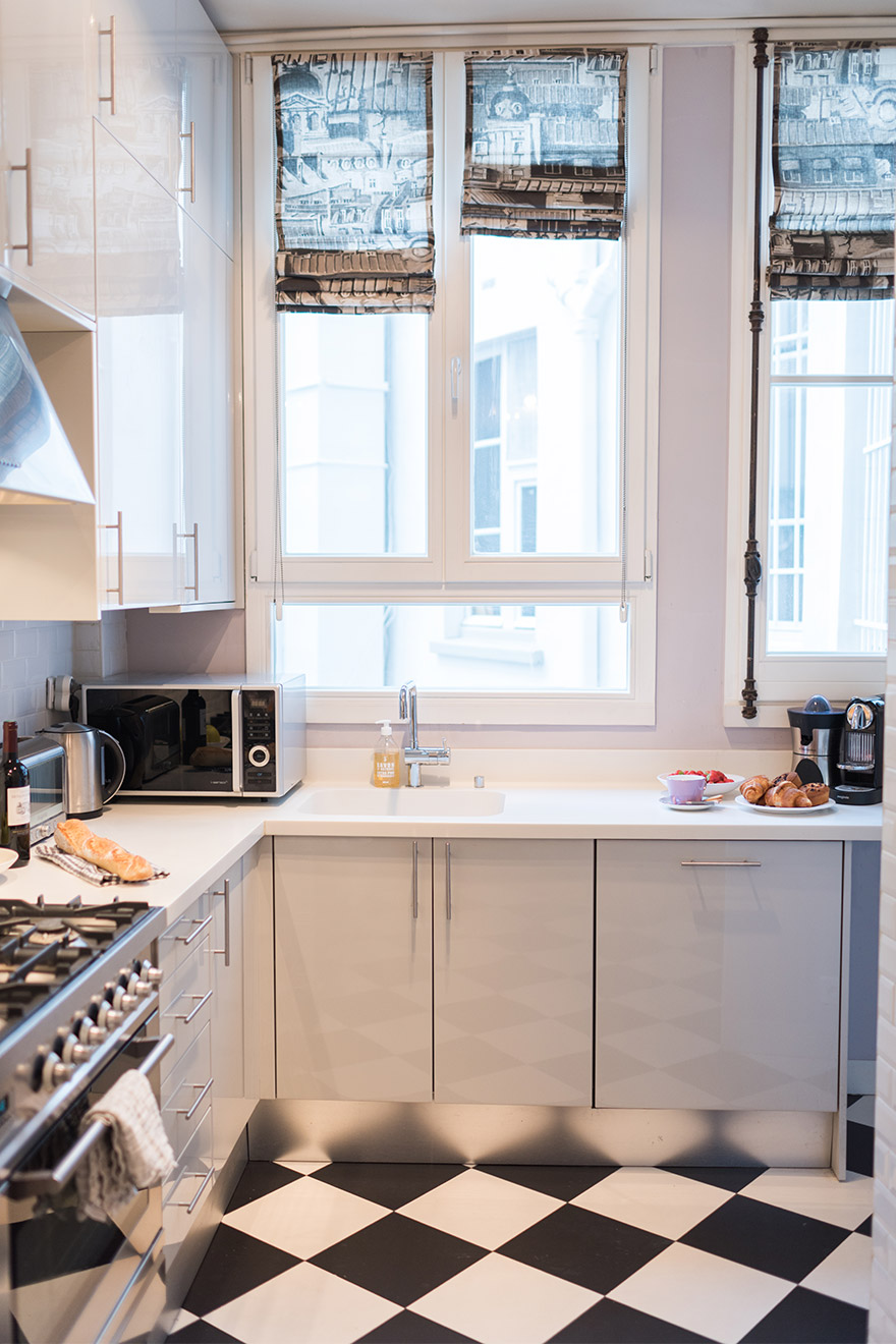 Modern kitchen equipped with everything you need in the Maubert vacation rental offered by Paris Perfect