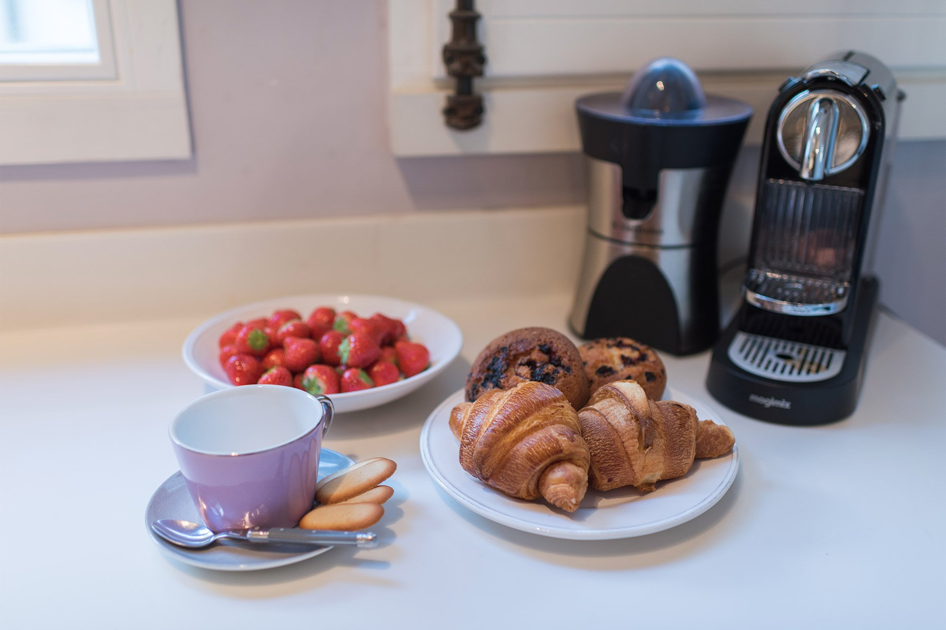 Fresh croissants, berries and coffee in the Maubert vacation rental offered by Paris Perfect
