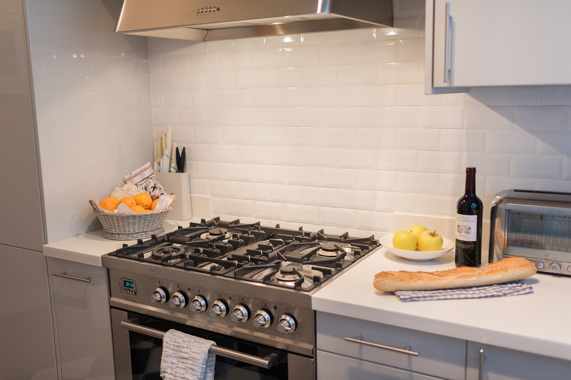 Four burner gas stove in the Maubert vacation rental offered by Paris Perfect