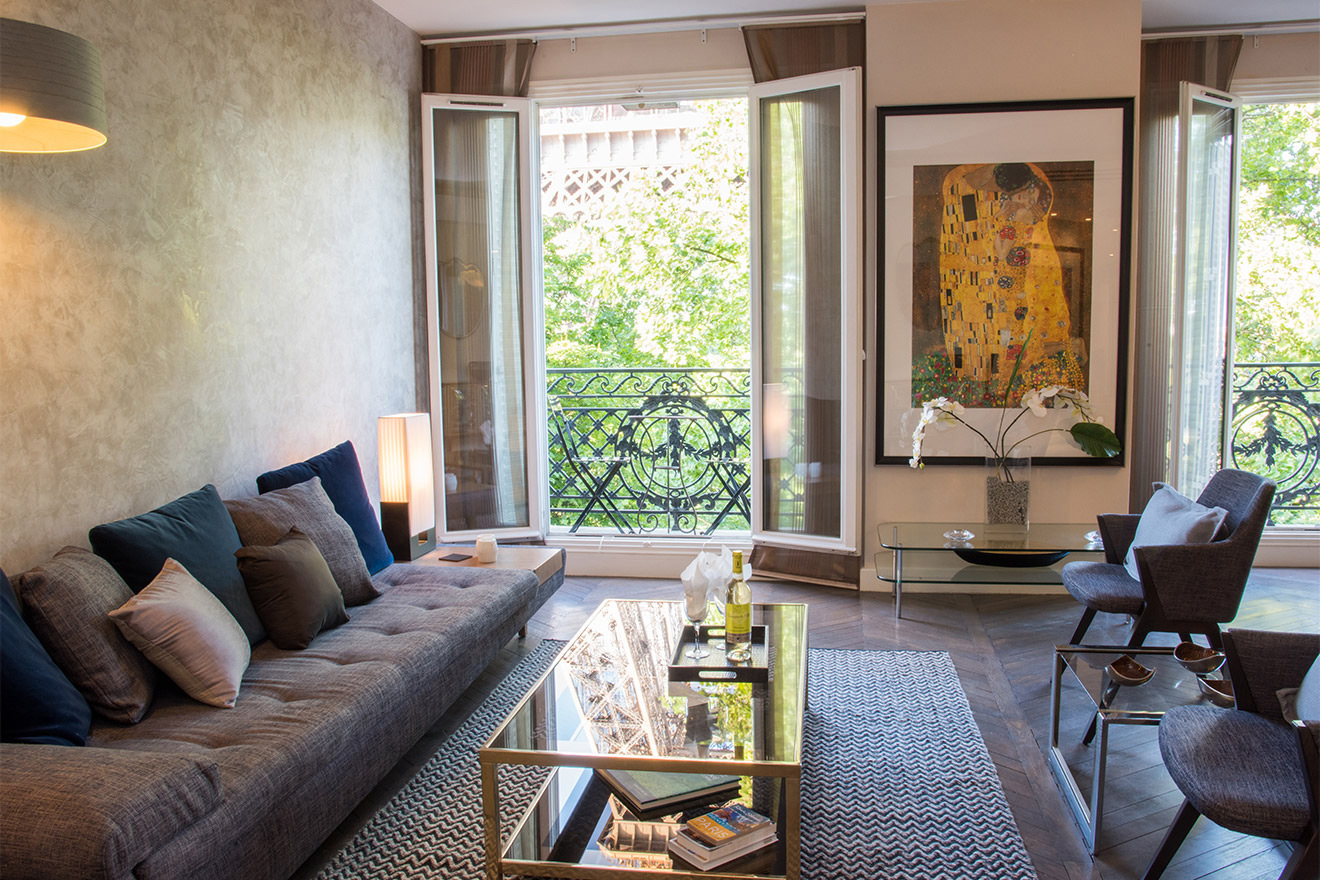 French windows let in lots of light in the Viognier vacation rental offered by Paris Perfect
