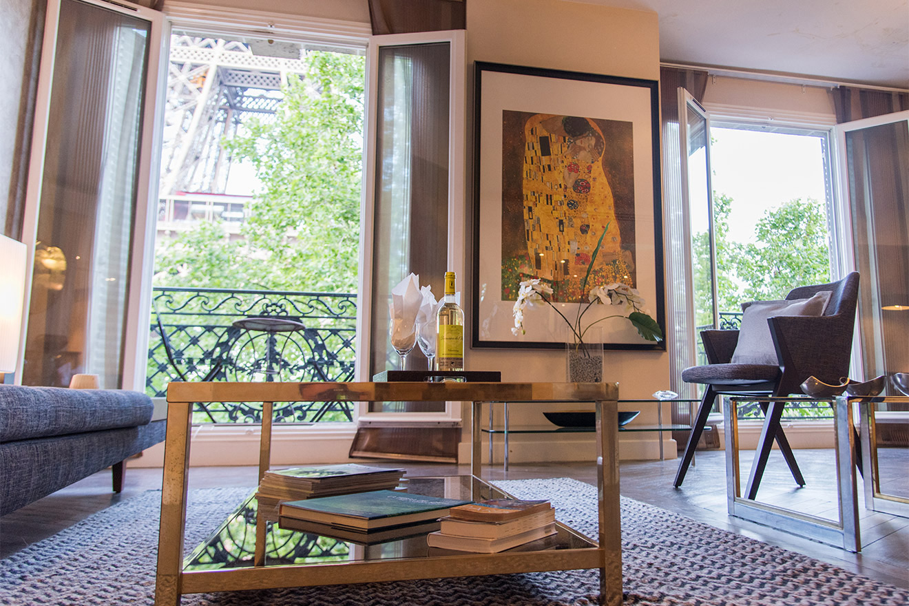 View of the Eiffel Tower from the double living room of the Viognier vacation rental offered by Paris Perfect