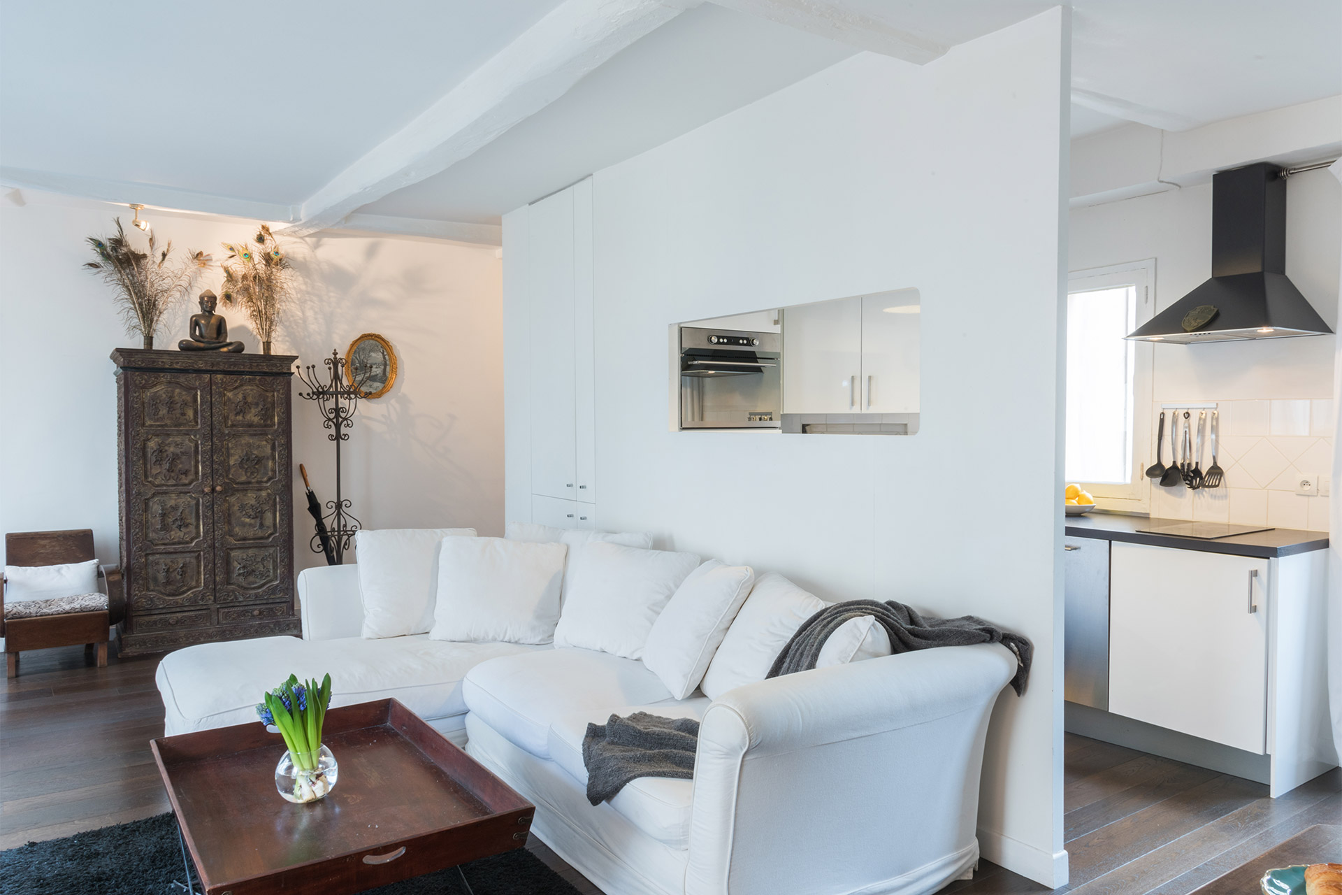 View of the living room and kitchen of the Jacquere vacation rental offered by Paris Perfect