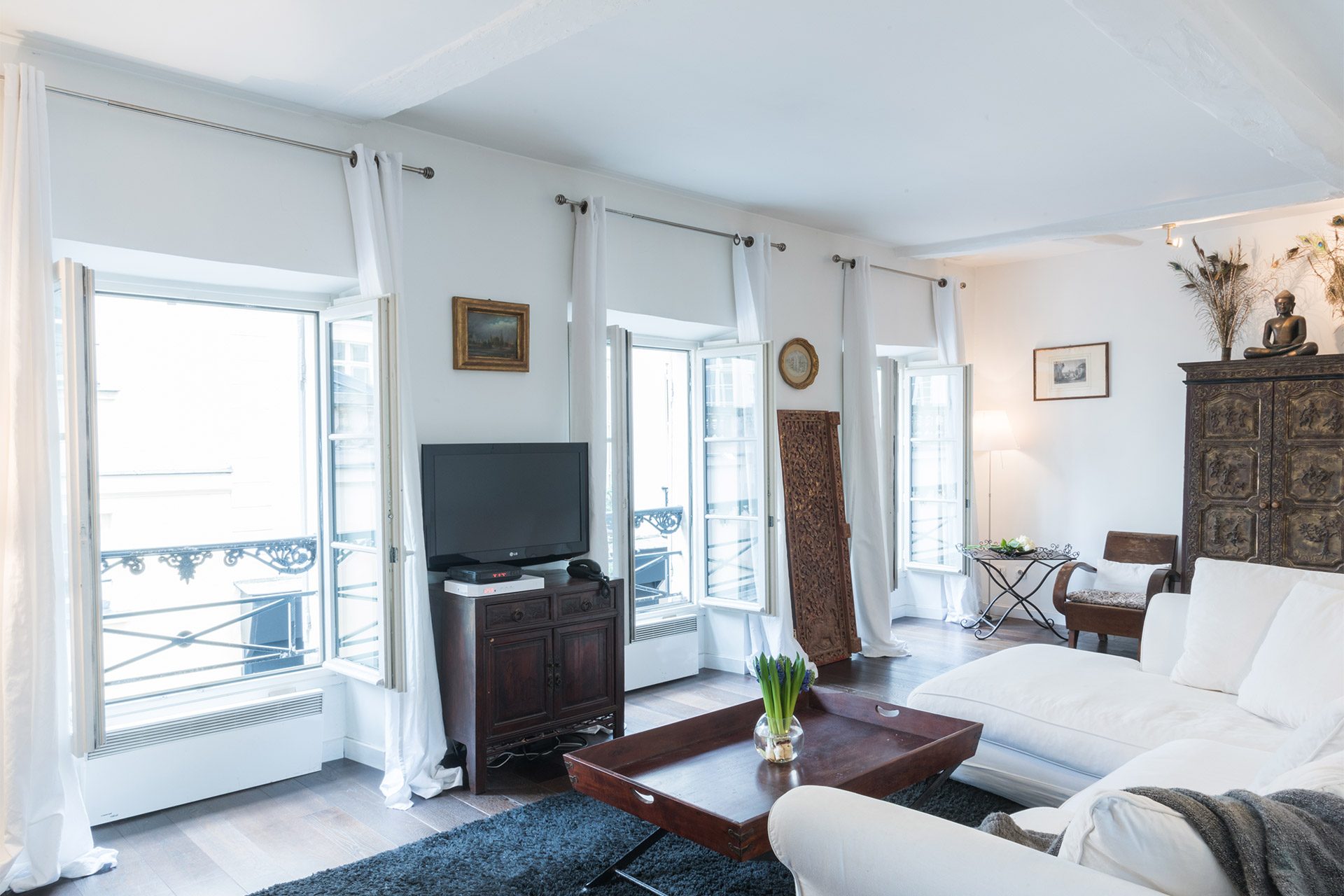 Large French windows in the Jacquere vacation rental offered by Paris Perfect