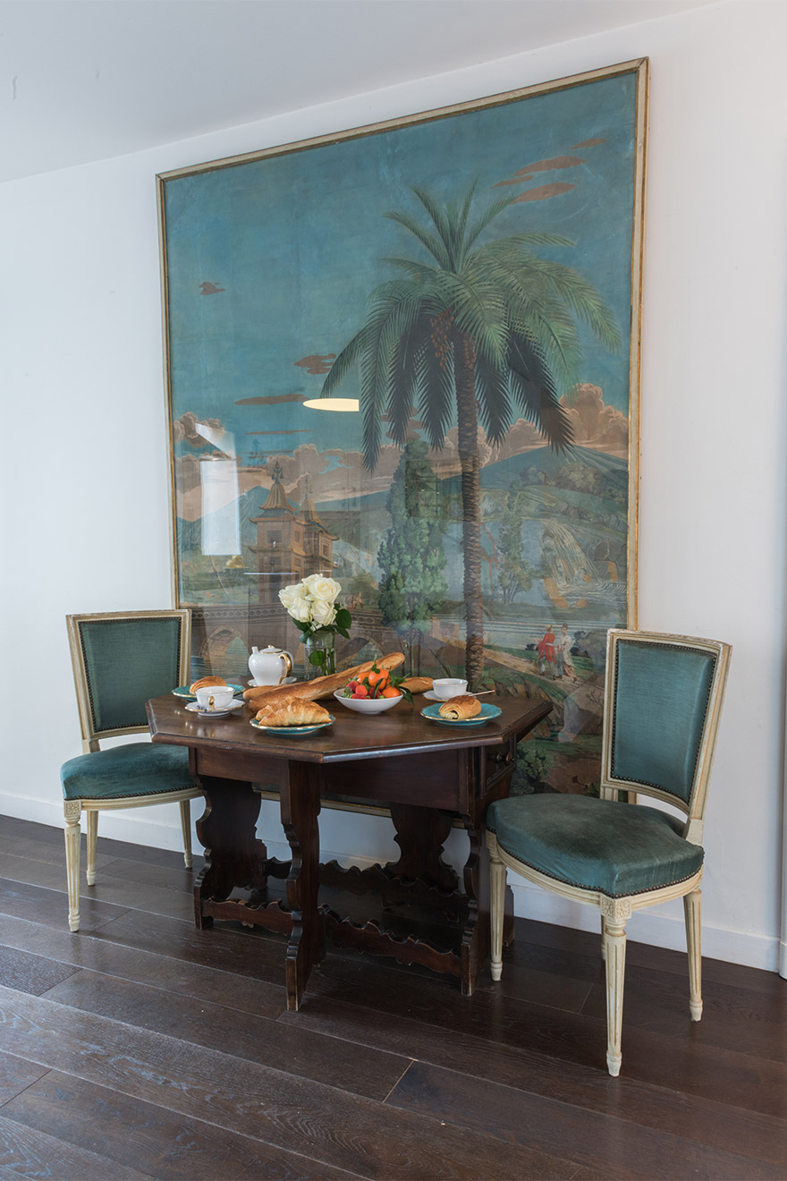 A touch of color with the dining chairs in the Jacquere vacation rental offered by Paris Perfect