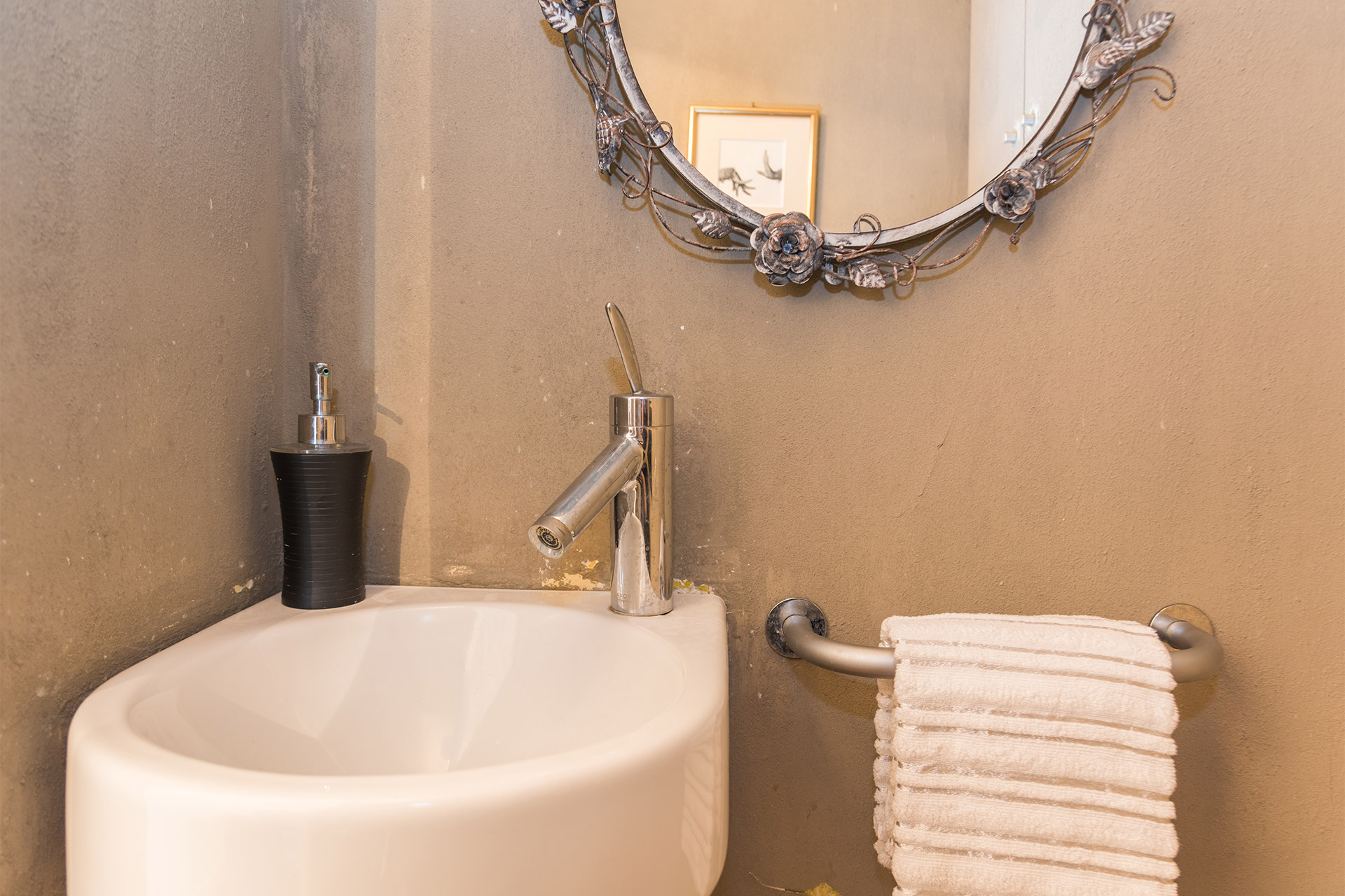 Sink, mirror and towel rack in the Jacquere vacation rental offered by Paris Perfect