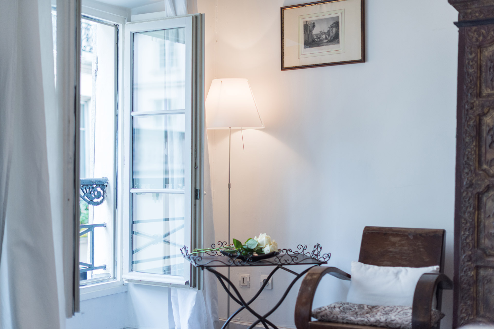 Charming seating area next to the window in the Jacquere vacation rental offered by Paris Perfect