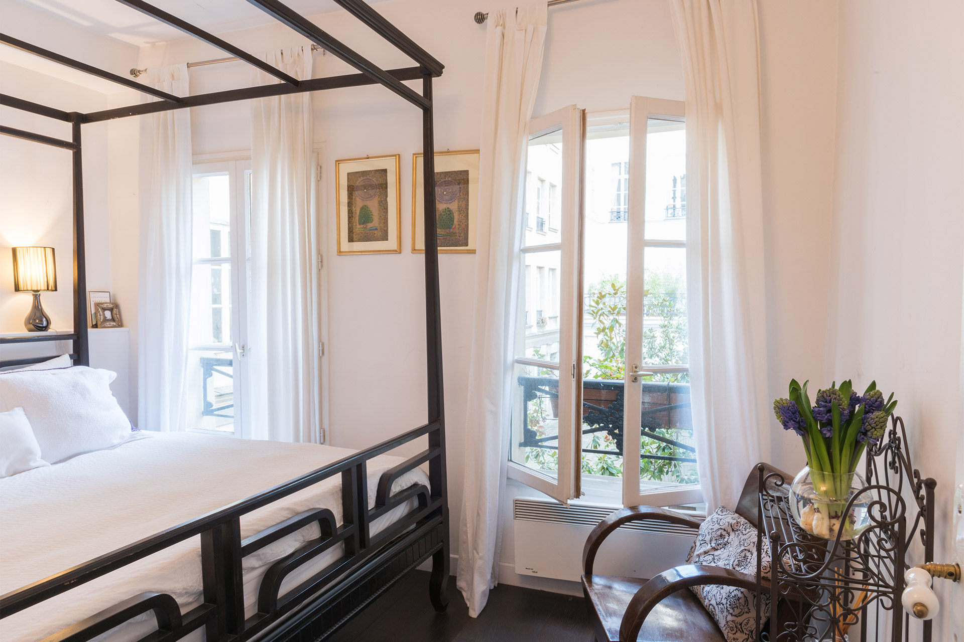 French window lets in lots of light in the Jacquere vacation rental offered by Paris Perfect