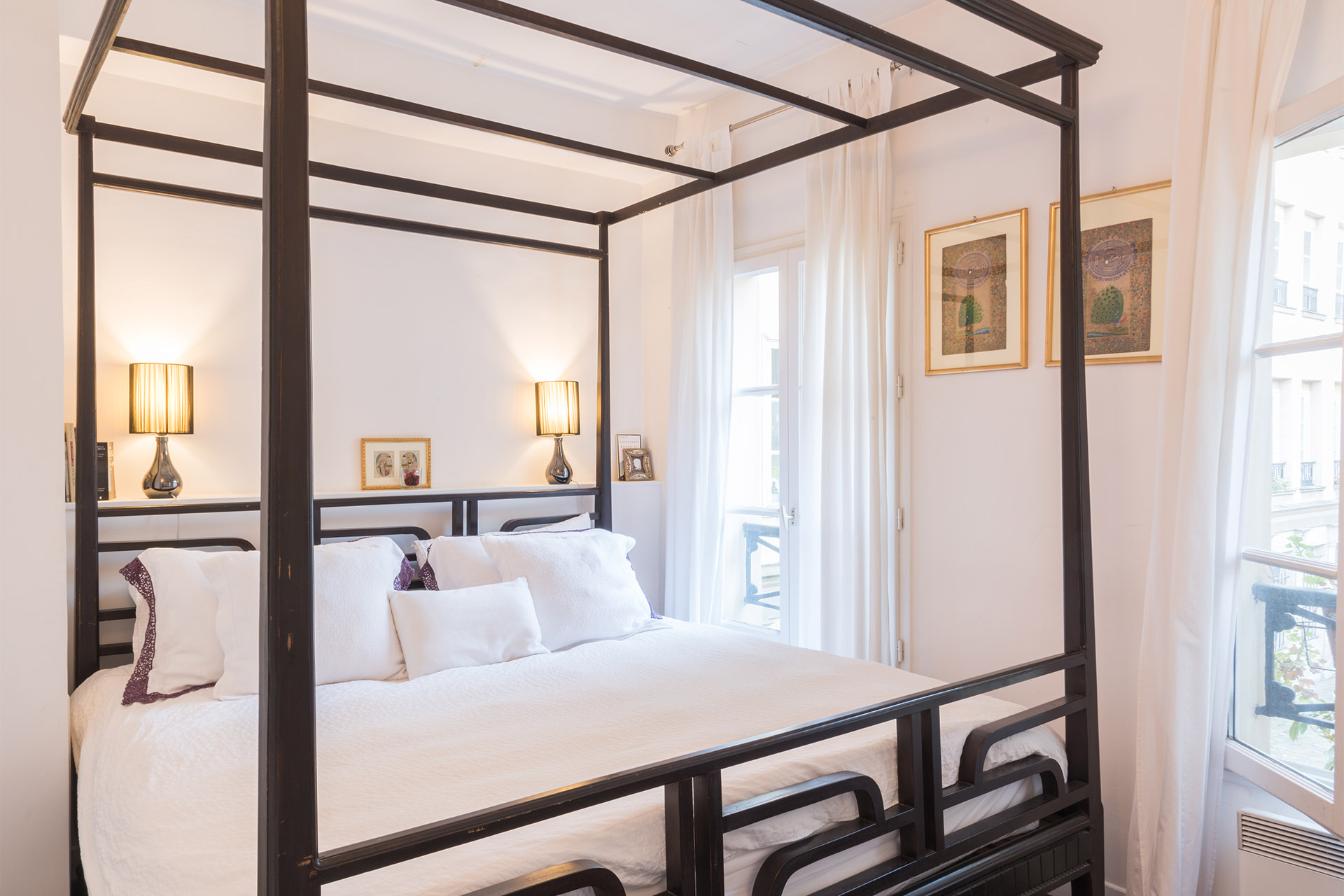 Bedroom 1 with a luxurious king size bed in the Jacquere vacation rental offered by Paris Perfect