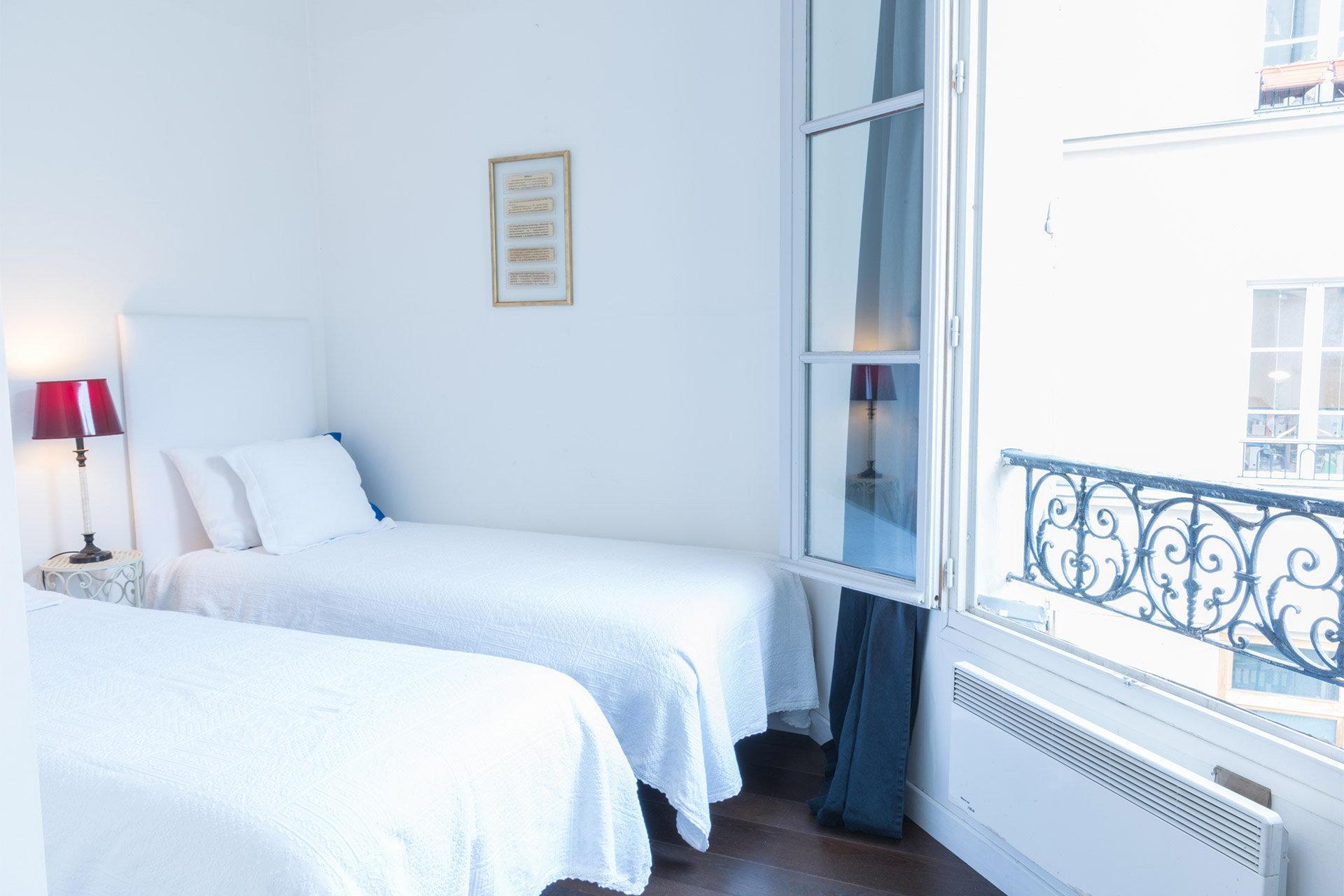 Second bedroom with two single beds in the Jacquere vacation rental offered by Paris Perfect