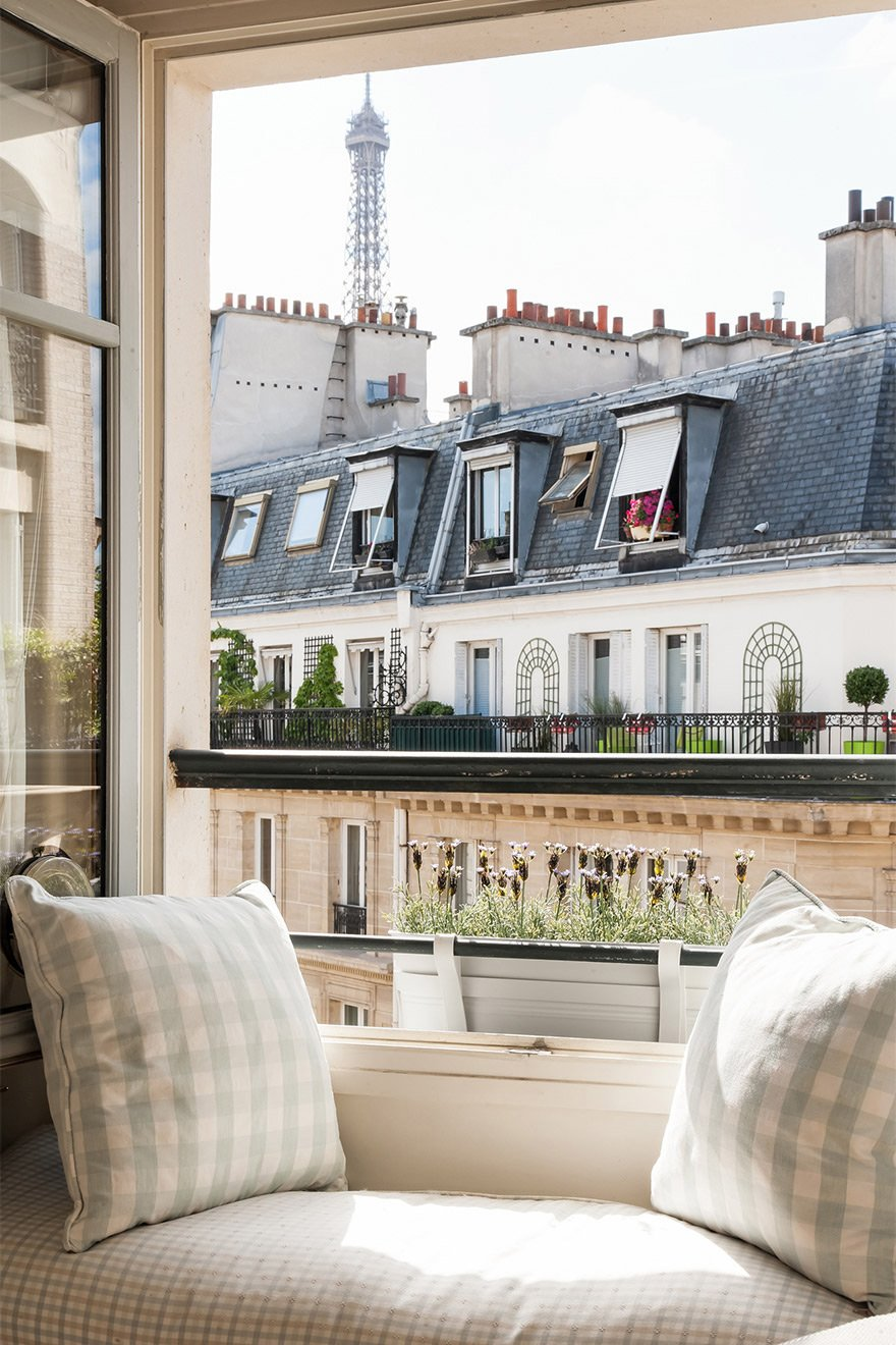 Eiffel Tower peeking over the rooftops in the Pomerol vacation rental offered by Paris Perfect