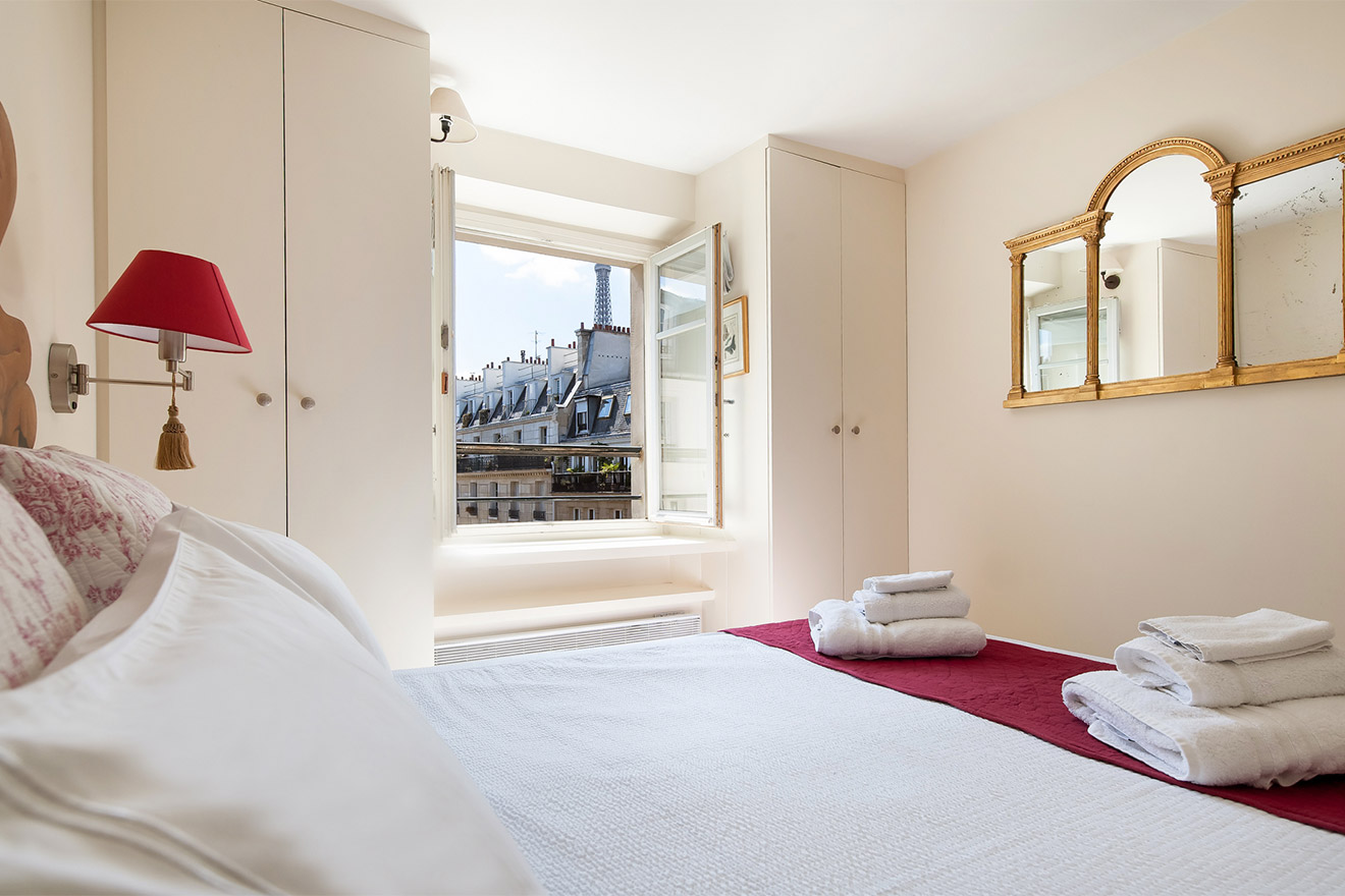 Romantic bedroom with views of the Eiffel Tower in the Pomerol vacation rental offered by Paris Perfect