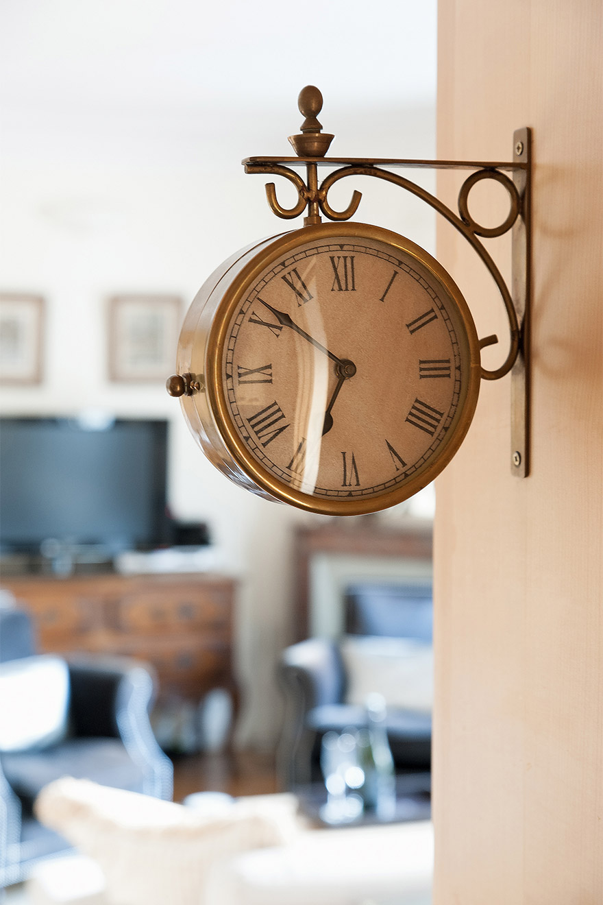 Classic style wall clock in the Romanée vacation rental offered by Paris Perfect