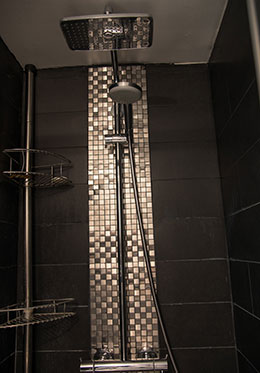 Enticing rainfall shower in the Carménère vacation rental offered by Paris Perfect