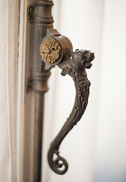 Antique carved handles on the French doors in the Carménère vacation rental offered by Paris Perfect