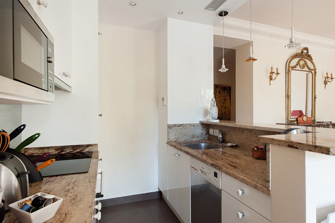 Kitchen with modern appliances in the Saint Amour vacation rental offered by Paris Perfect