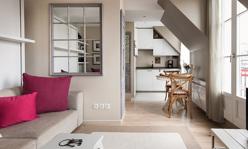 Open floorplan leads from living room to kitchen of the Saumur vacation rental offered by Paris Perfect