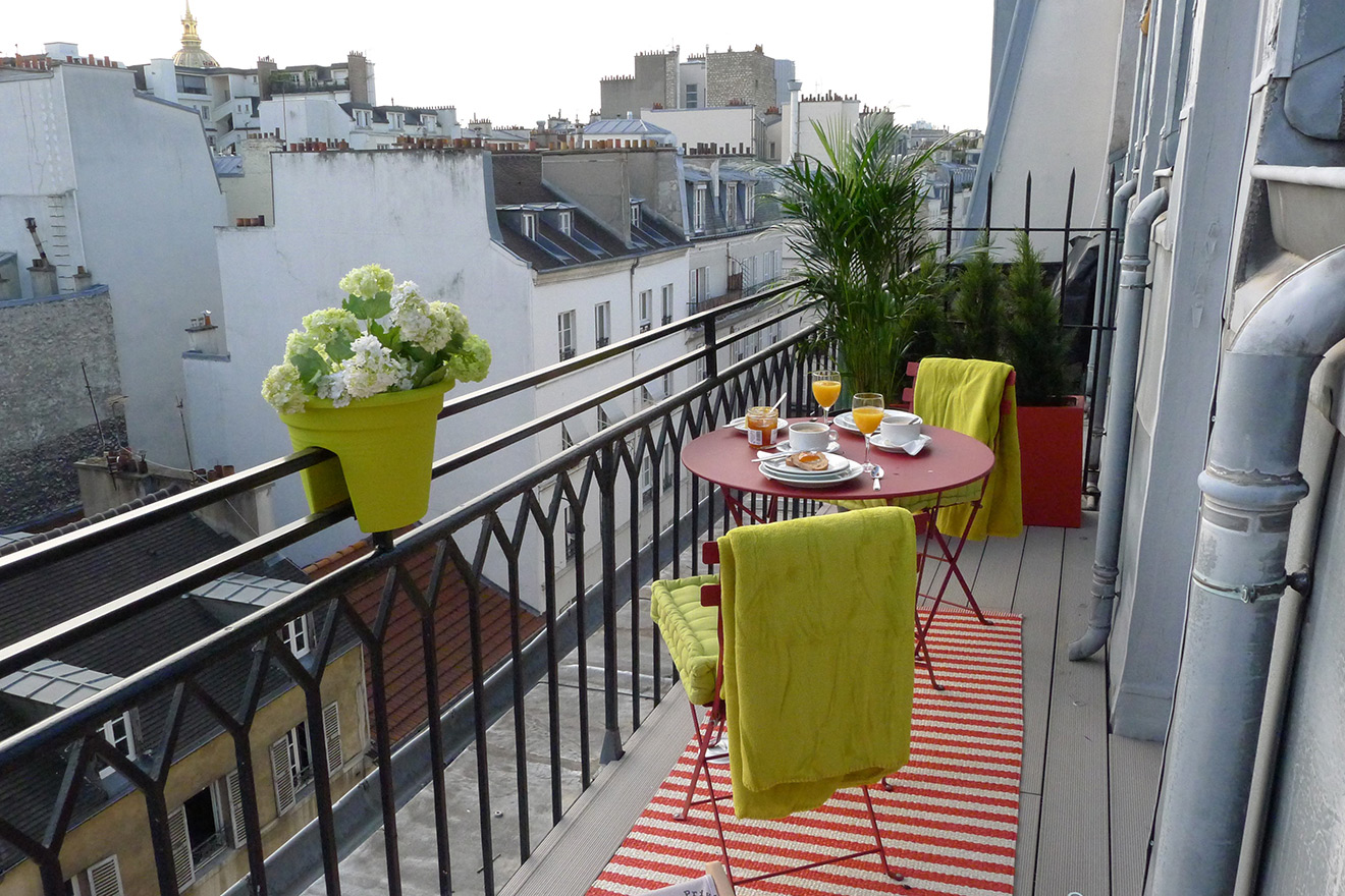Sit outside on the sunny balcony of the Saumur vacation rental offered by Paris Perfect