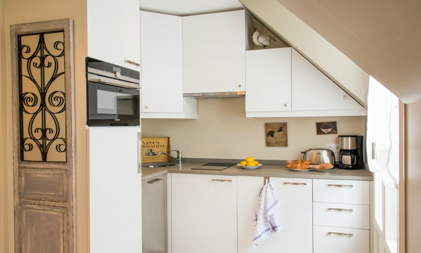 The kitchen is polished and easily accessible in the Saumur vacation rental offered by Paris Perfect