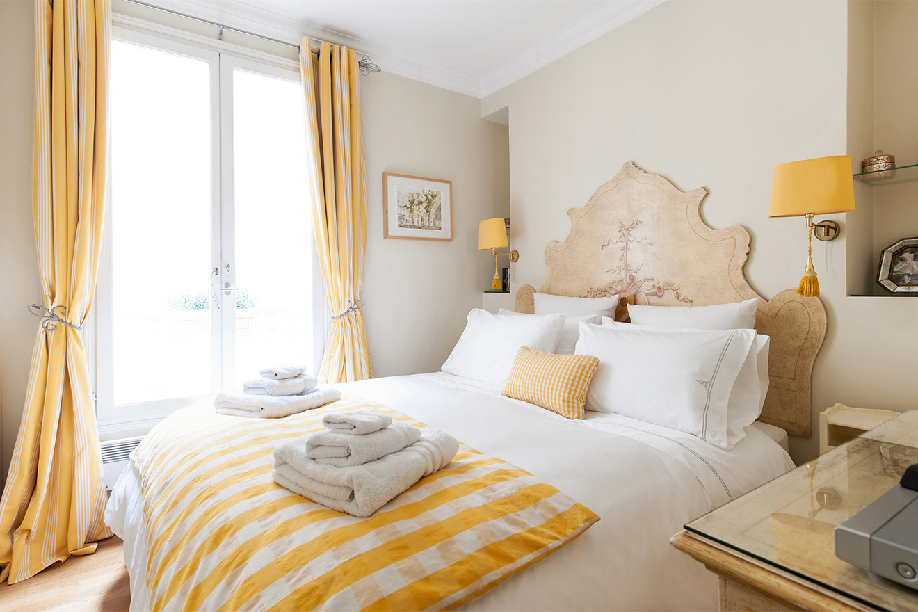 Bright bedroom of the Saint Julien vacation rental offered by Paris Perfect