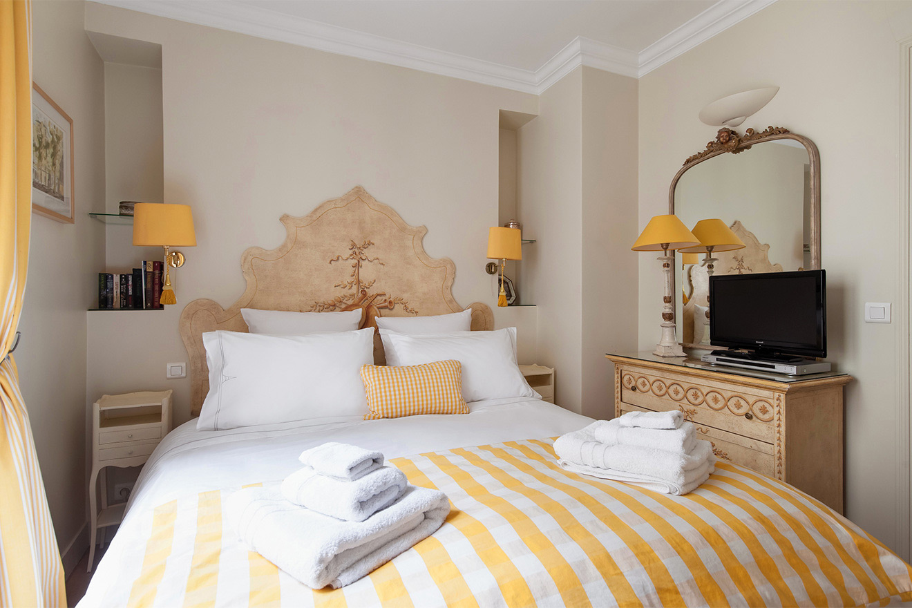 Watch a DVD in bed in the Saint Julien vacation rental offered by Paris Perfect