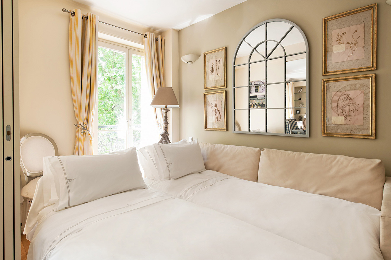 High-quality sofa converts to two single beds in the Saint Julien vacation rental offered by Paris Perfect