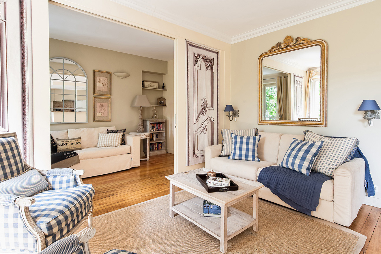 Lots of seating in the living room of the Saint Julien vacation rental offered by Paris Perfect
