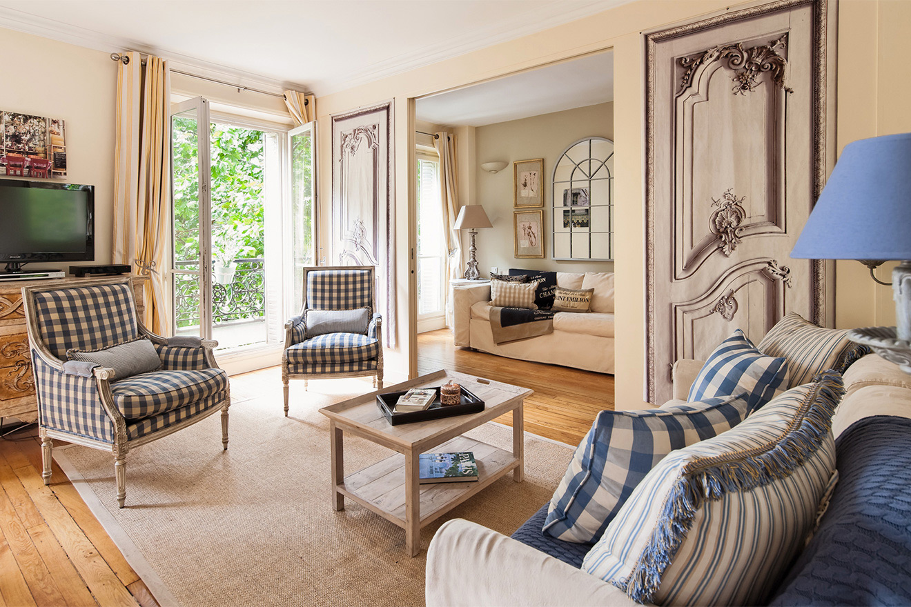 French doors in large living area of the Saint Julien vacation rental offered by Paris Perfect