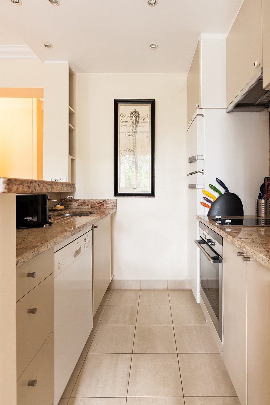 Modern kitchen with oven and induction cooktop in the Saint Julien vacation rental offered by Paris Perfect