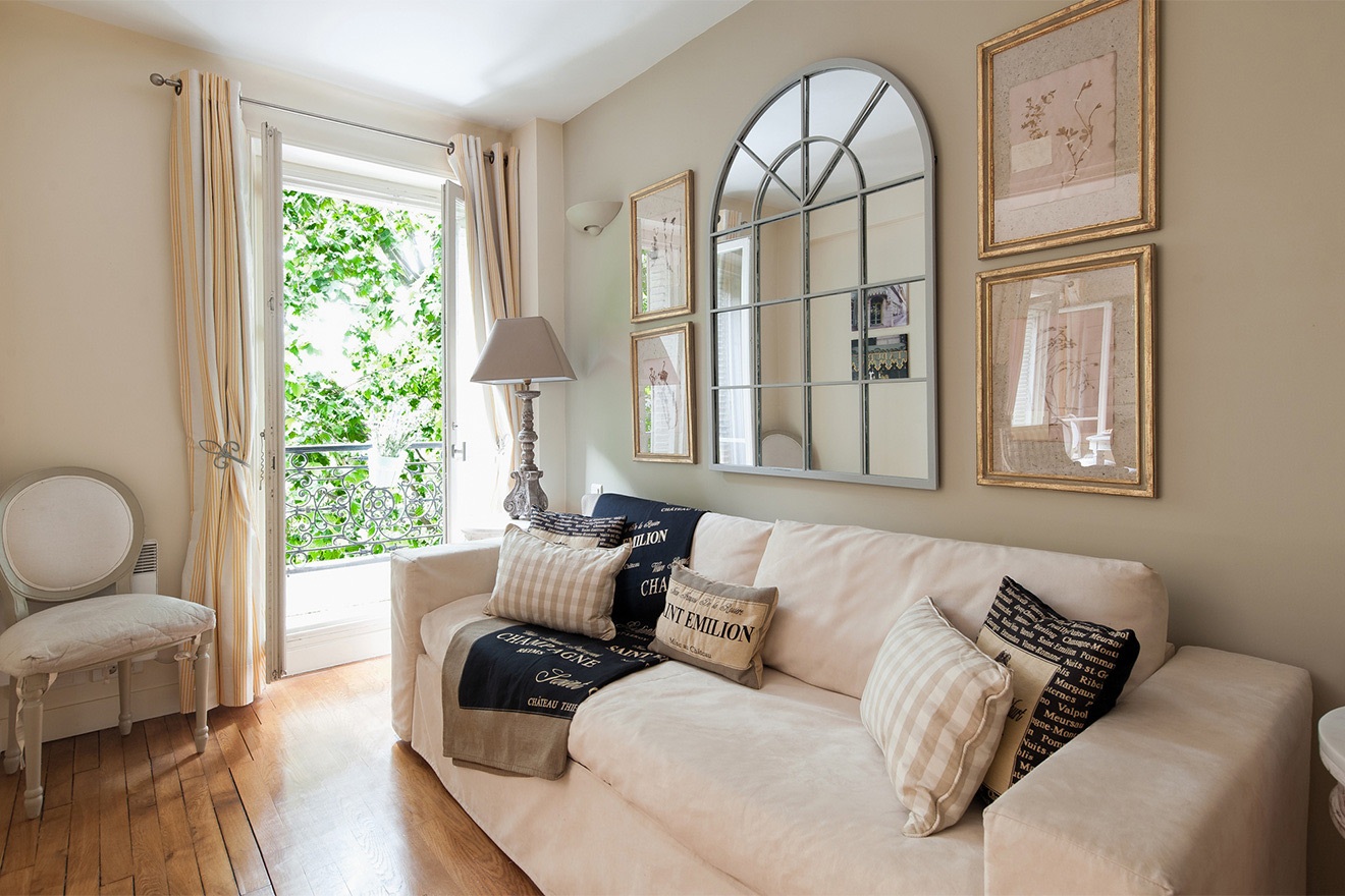 Sunny second living area with sofa bed in the Saint Julien vacation rental offered by Paris Perfect