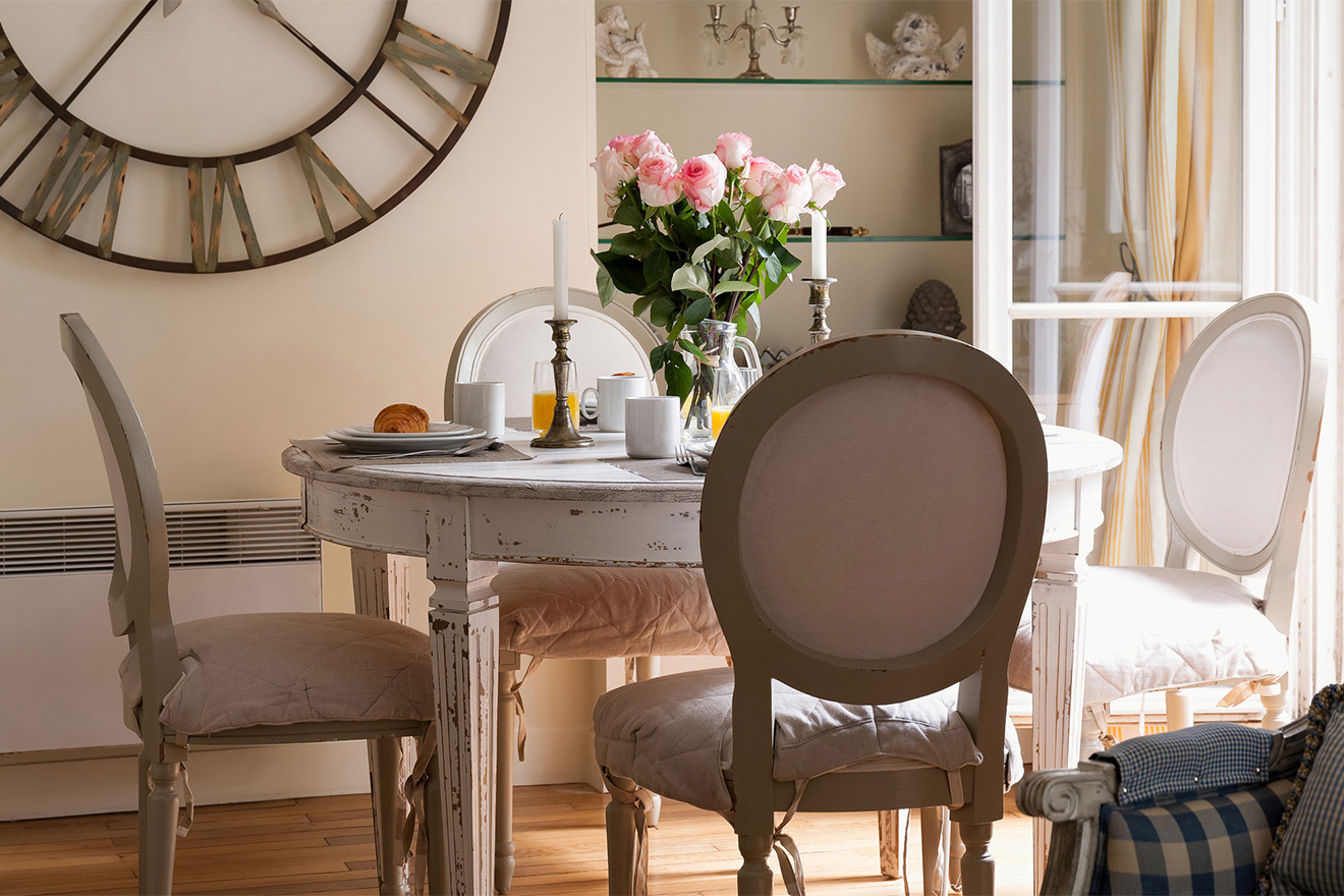 Classic dining table expands to seat eight people in the Saint Julien vacation rental offered by Paris Perfect