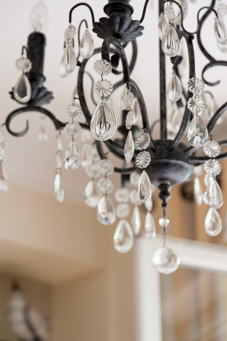 Elegant Chandelier over the dining table in the Saint Julien vacation rental offered by Paris Perfect