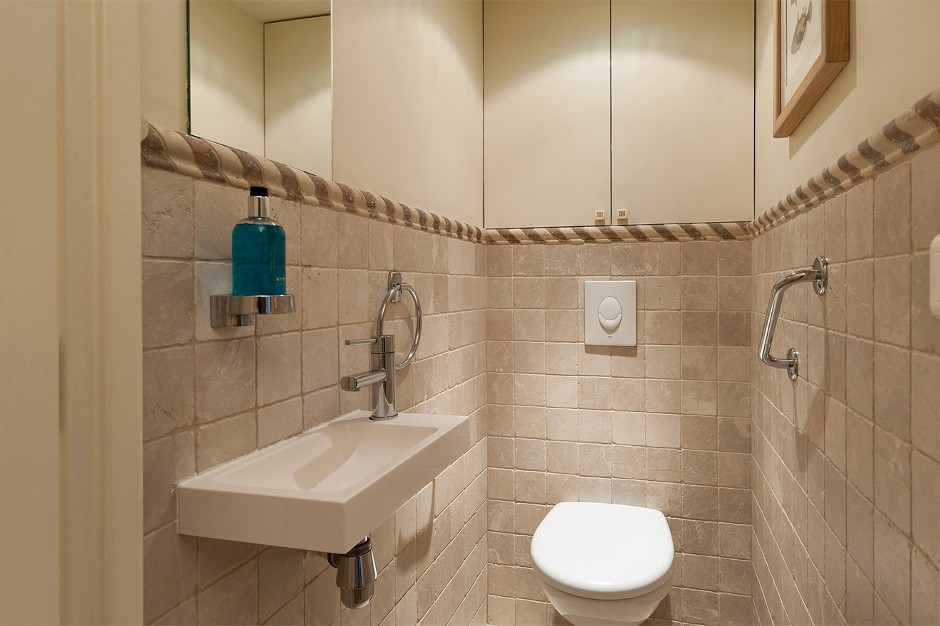Separate half bath with toilet and sink in the Saint Julien vacation rental offered by Paris Perfect