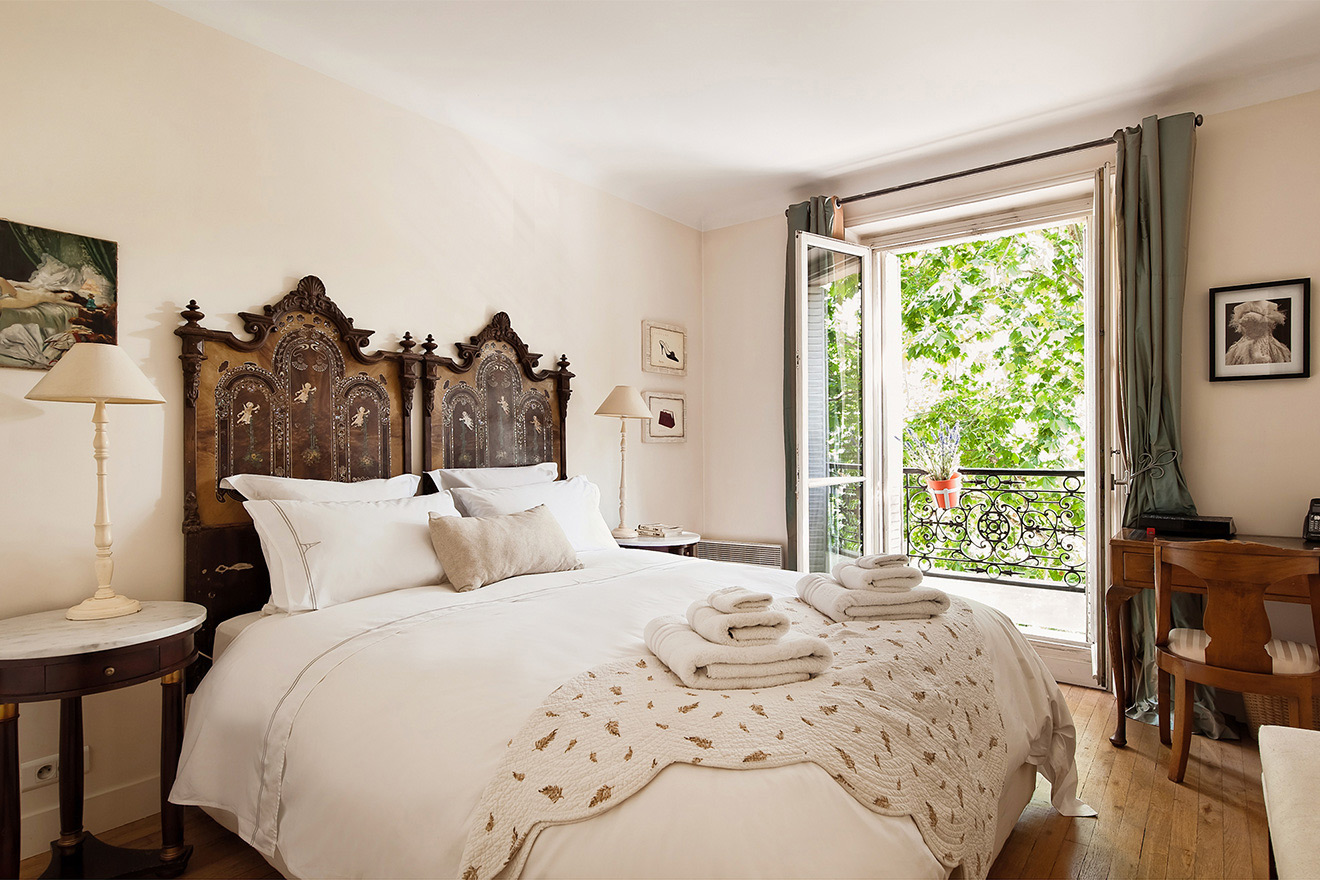 Romantic bedroom in beautiful French provençal style in the Volnay vacation rental offered by Paris Perfect