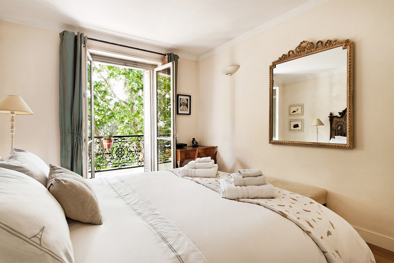 Romantic bedroom of the Volnay vacation rental offered by Paris Perfect