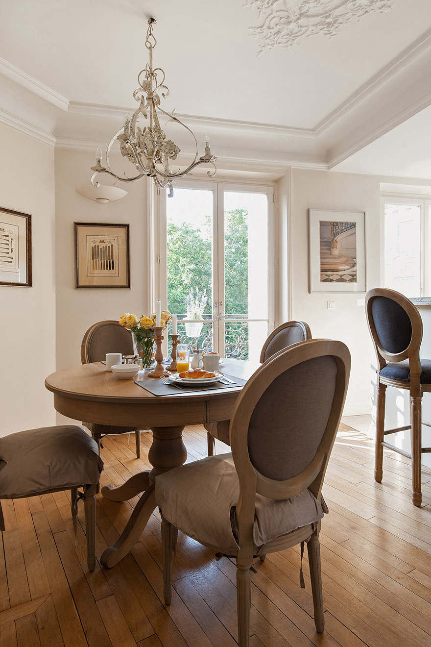 Dining table is perfect for entertaining in the Volnay vacation rental offered by Paris Perfect