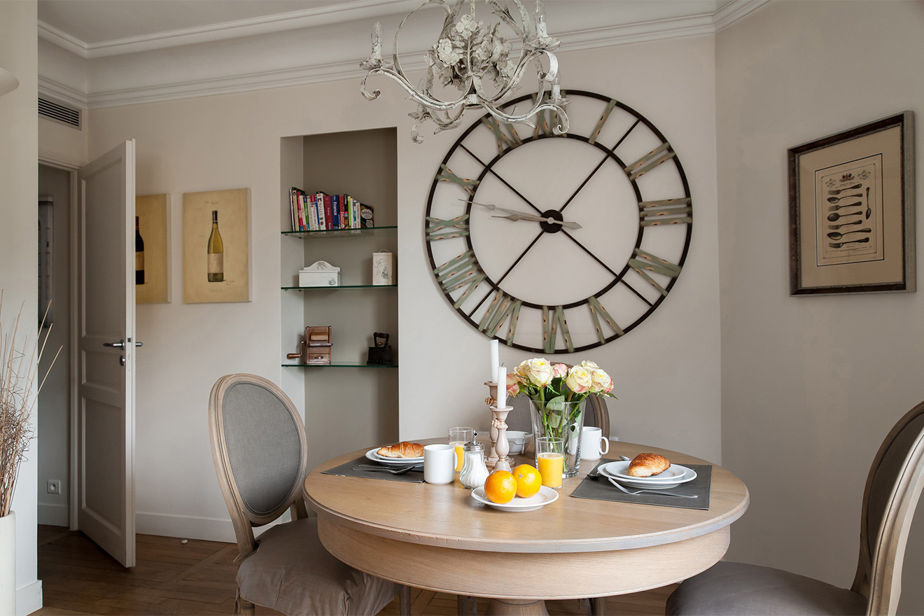 Breakfast on the dining table in the Volnay vacation rental offered by Paris Perfect