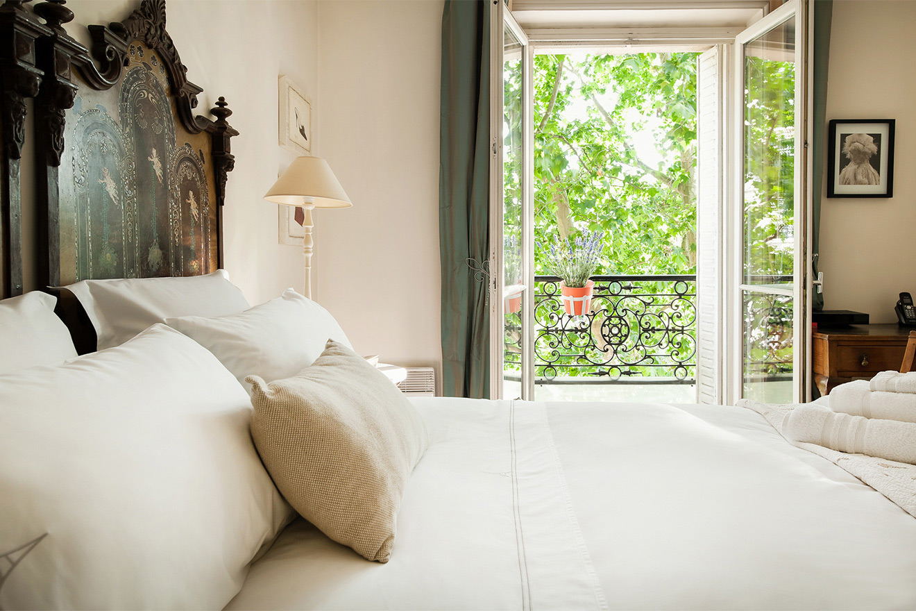 Large windows let in lots of light in the Volnay vacation rental offered by Paris Perfect