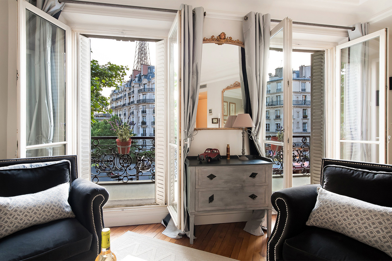French doors with stunning views in the Volnay vacation rental offered by Paris Perfect