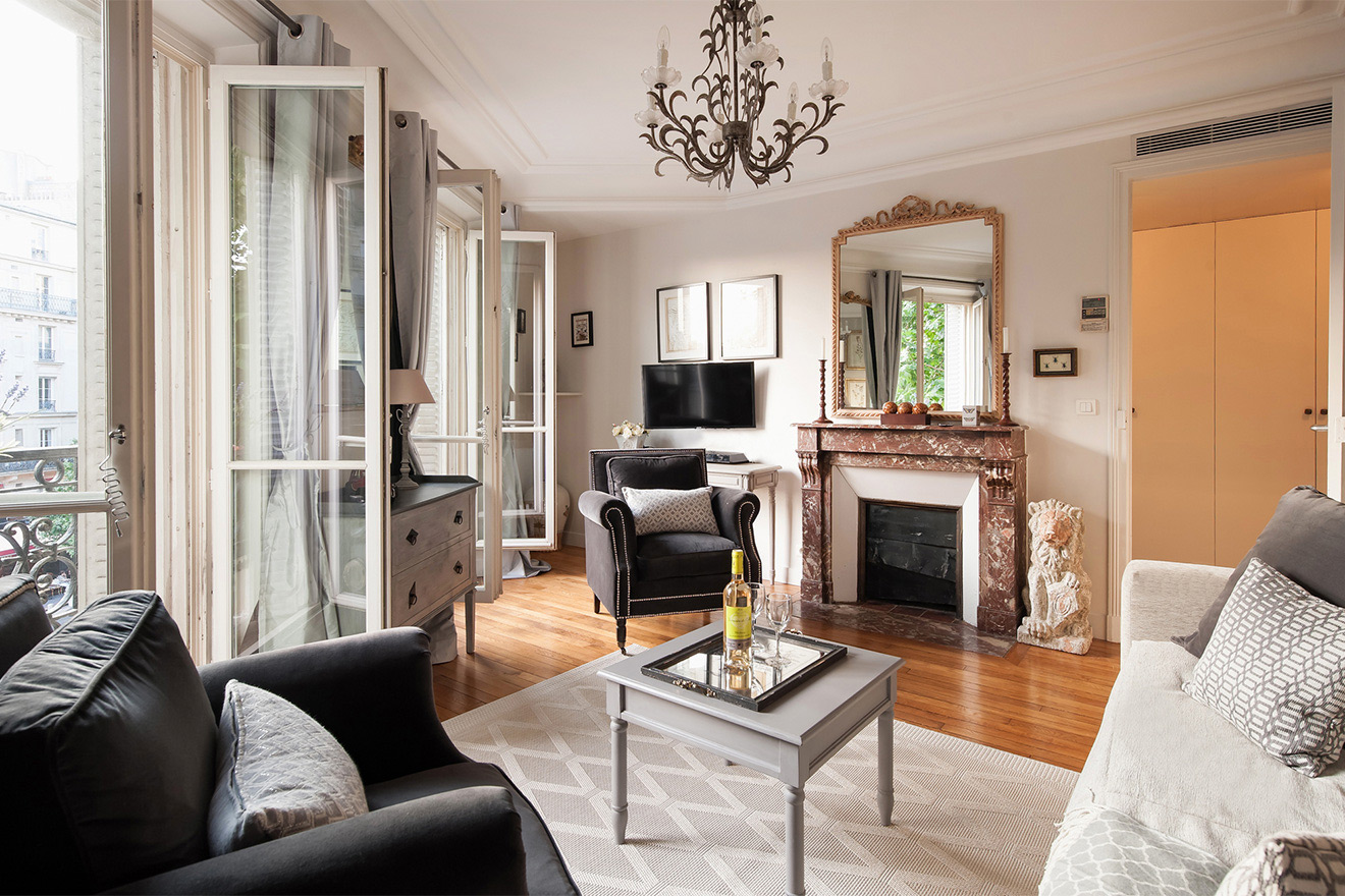 Living room with original fireplace, flat-screen TV and DVD in the Volnay vacation rental offered by Paris Perfect