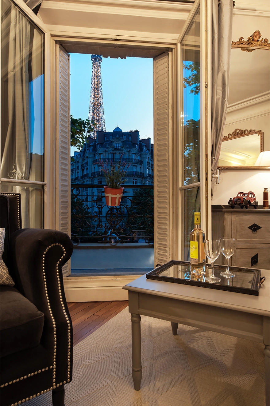 Enjoy cozy evenings watching the Eiffel Tower in the Volnay vacation rental offered by Paris Perfect