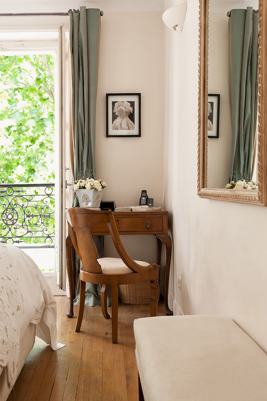 Charming wooden desk in the corner of the bedroom of the Volnay vacation rental offered by Paris Perfect