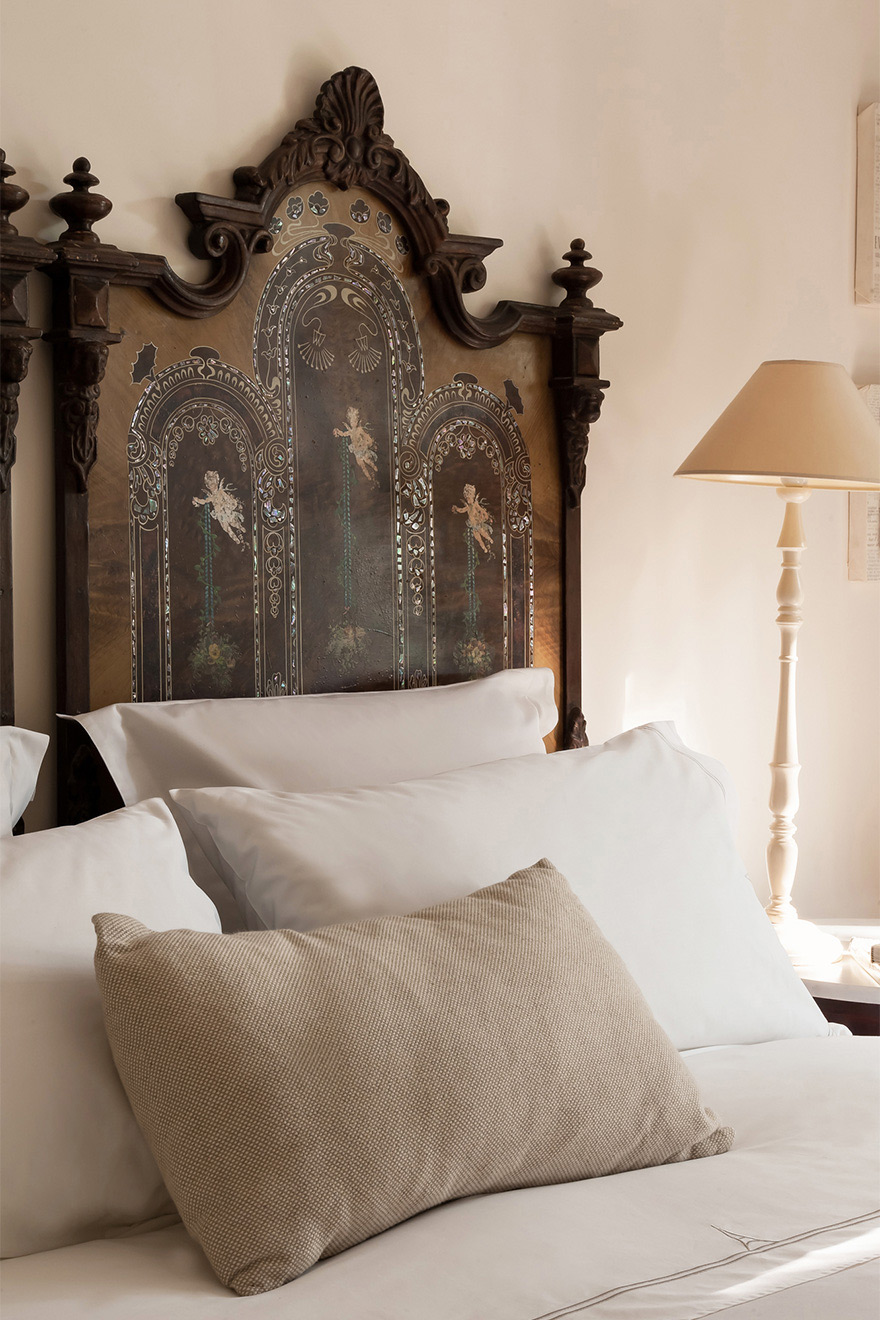 Charming antique headboards in the Volnay vacation rental offered by Paris Perfect