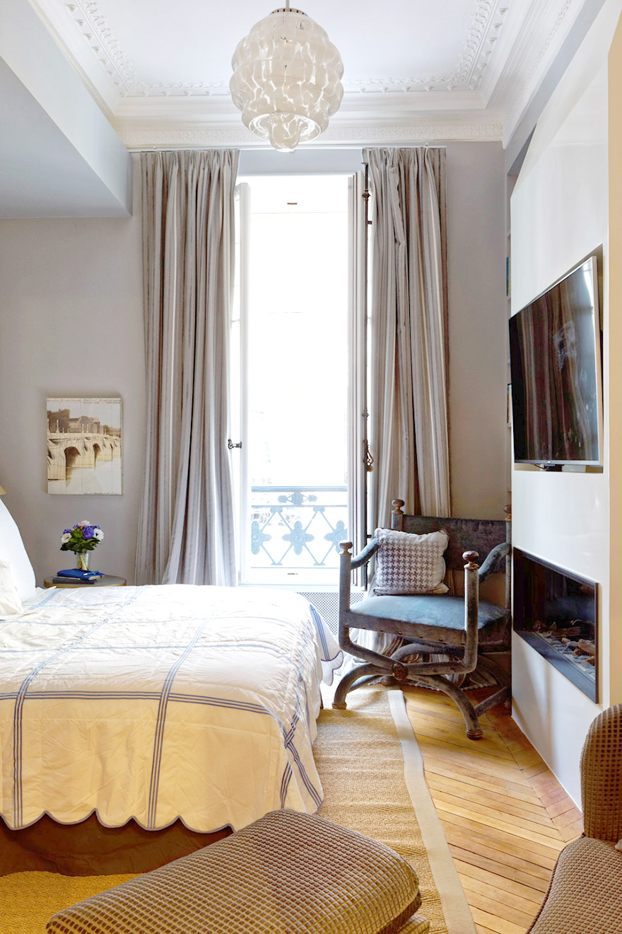 This light and airy bedroom in the Bailly Paris vacation rental is the perfect retreat for your next Paris get-away