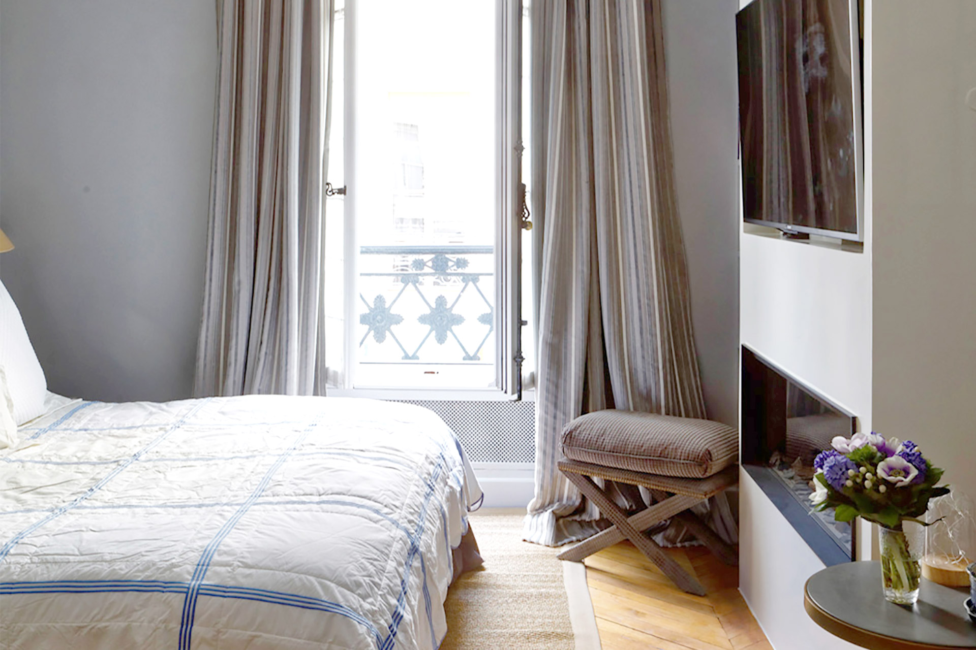 Beautiful touches in bedroom one in the Bailly Paris vacation rental