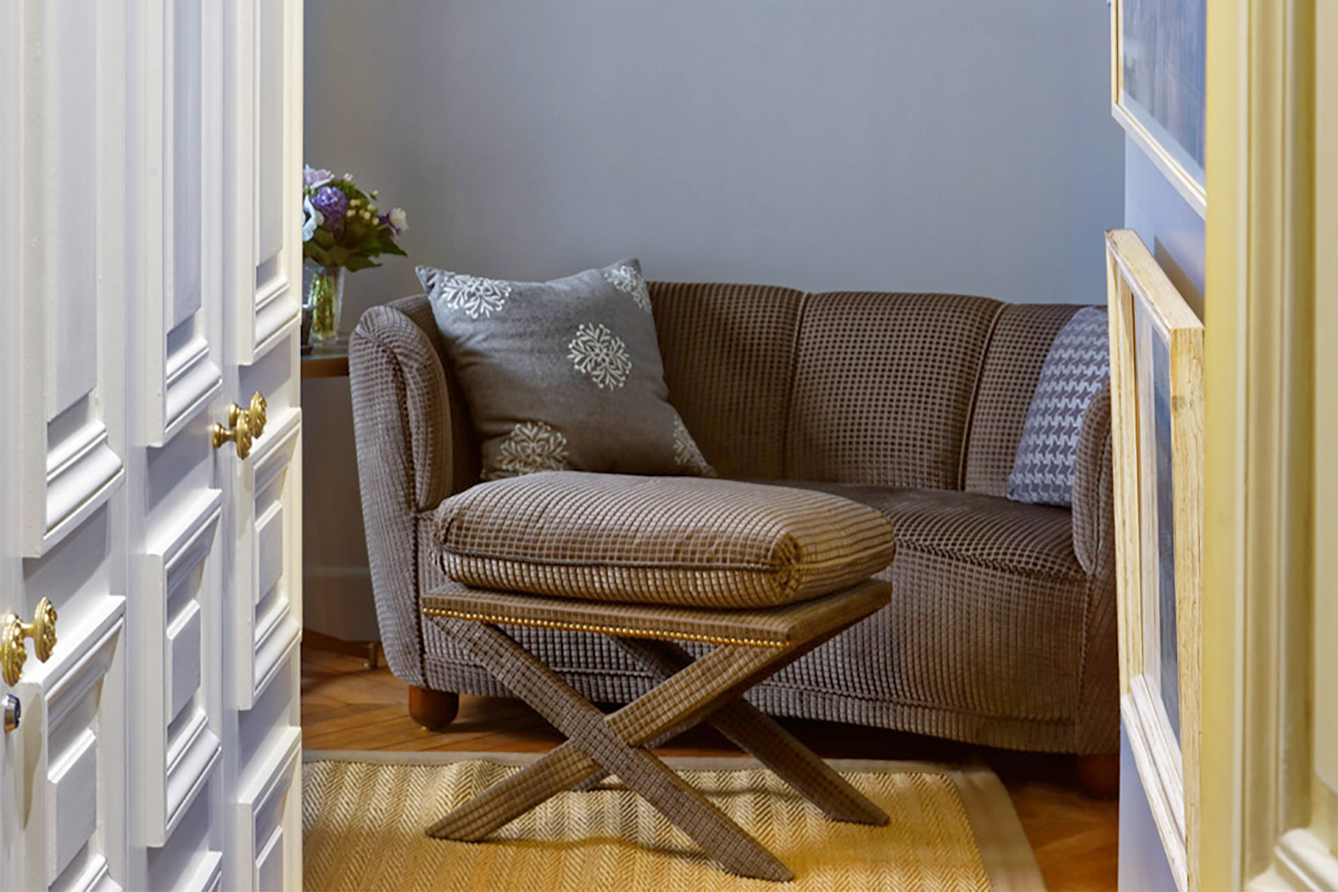 Comfy seating in bedroom one plus storage cupboards in the hallway in the Bailly Paris vacation rental