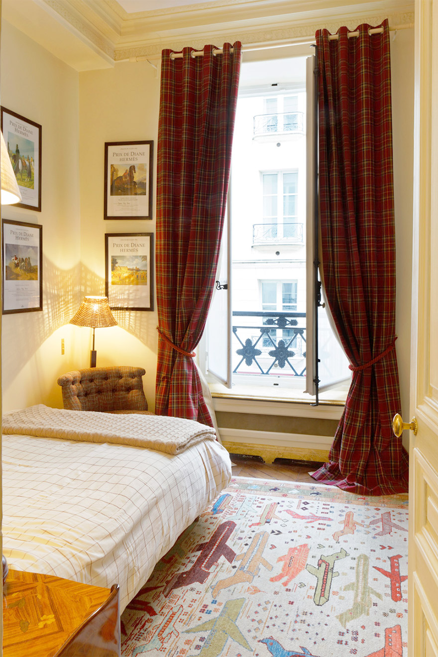 The large French window in bedroom two in the Bailly Paris vacation rental lets in plenty of light
