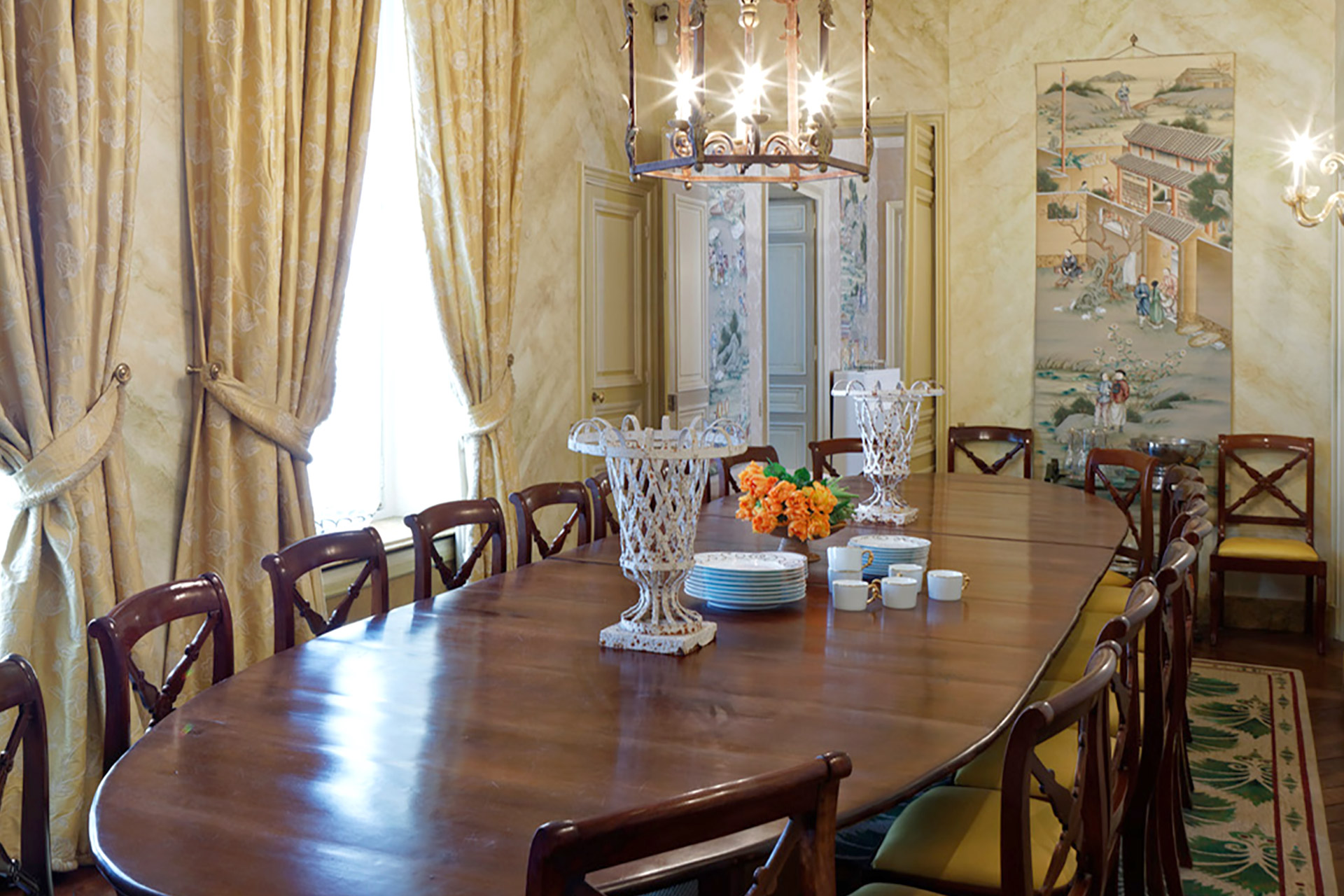 Impress guests with dinners around this kingly dining table in the Bailly Paris vacation rental